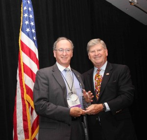 Jim Lampke receiving Rhyne Award from IMLA Executive Director Chuck Thompson in San Francisco on October 1, 2013